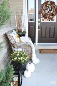 Looking for new ideas to decorate your front porch for Fall? Come see my COZY RUSTIC FALL PORCH Decor with lots of DIY home decor ideas to add beautiful curb appeal to your home! Easy fall decorating ideas for using pumpkin decorations, fall planters, mums, fall wreath, lanterns and more. See all the porch decorating tips!
