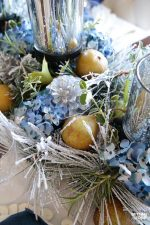 This quick and easy transitional Thanksgiving to Christmas DIY Centerpiece only takes 10 minutes to make! This is such an elegant DIY decor idea  - perfect for the Thanksgiving table that you can leave out until Christmas! Includes a FREE printable checklist of mix and match supply ideas so you can create your very own centerpiece that's unique to you! This also makes a stunning hostess gift too!