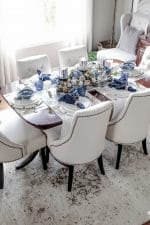 Learn how to create these elegant fall table settings with a blue and white color palette using white dishes, blue and white chinoiserie bowls, navy napkins, sparkly mercury glass and a transitional holiday centerpiece accented with fall herbs, garden greenery and orchard pears. See loads of Fall and Thanksgiving entertaining tips and ideas with this multi blog entertaining tour!