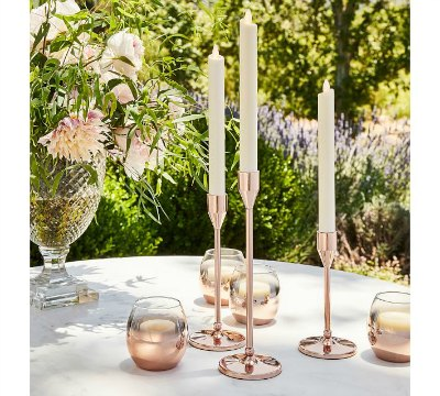 Update your table decor instantly with these gorgeous Rose Gold Candlesticks with a updated modern style!