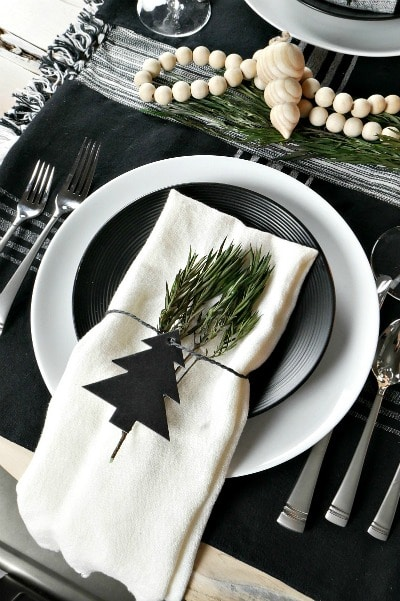 Love this! See how to create this beautiful Christmas Scandinavian Inspired Table! Easy DIY entertaining idea for the home.