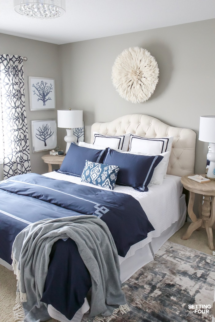 See my new guest bedroom updates including a gorgeous white juju hat that I hung above the bed, new navy blue duvet cover with matching shams and new column table lamps!  Decorating this room has been so much fun!