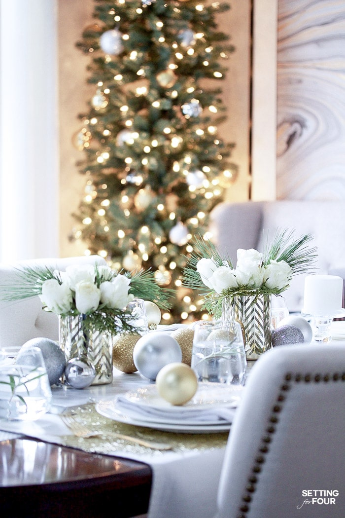 Learn how to create this beautiful Gold and White Glam Christmas tablescape including these rose and pine winter floral arrangements!