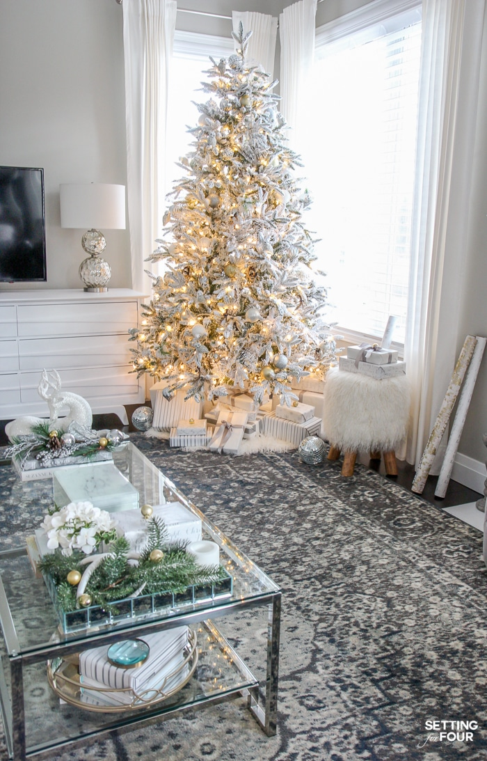 white flocked christmas tree in a transitional style home see the decorating tips to get - Decorated Flocked Christmas Trees
