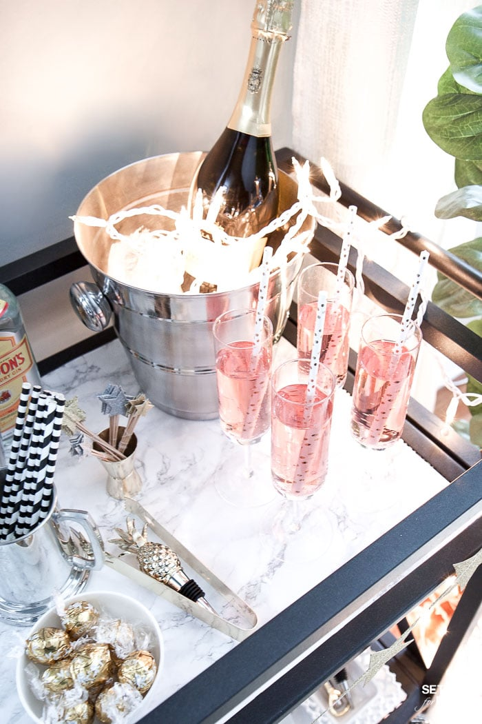 Bar Carts and New Year's Eve Parties go hand in hand! Learn how to create a fun New Years Eve Bar Cart with festive party supplies, delicious food and bubbly drinks! Celebrate the New Year in style!