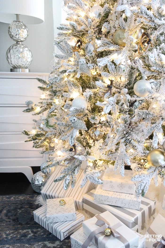 Looking for Christmas tree decorating inspiration? See my ELEGANT FLOCKED CHRISTMAS TREE - WHITE AND GOLD GLAM STYLE! I show you how I use mesh ribbon, beautiful white and gold christmas balls, icicle ornaments and sparkly owls to decorate a traditional christmas tree with a glam transitional style.