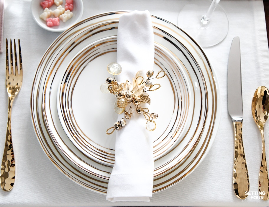 Valentines Day Dinner Party Ideas : To celebrate those you cherish! Gold flatware, white and gold dinnerware and pink and white gummy bear treats.