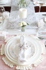 Blush Pink Valentines Day Table Decorations: Want to decorate your table for Valentine's Day but not sure where to start or you want to try something new? Take a look at this lovely Blush Pink Valentine's Day Table Decor! Read this step by step diy decor lesson - you'll learn how to set and decorate a lovely blush pink table for a dinner party or party of two, so you can copy it in your home! Celebrate Valentine's Day with these lovely entertaining tips including ideas for dish ware, flatware, glassware, a pretty rose centerpiece idea, and fun Valentines Day take-home gift ideas for your guests! These table decor ideas would also be perfect for a Valentine's Day wedding reception or bridal shower!