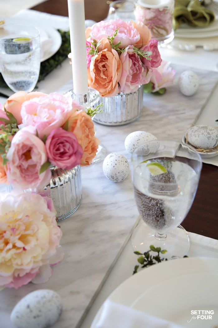 Beautiful Easter dinner party planning decor ideas. Floral centerpieces and DIY Easter egg decorations.