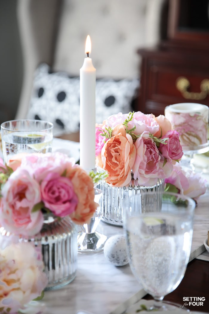 Tablescape with candlelight and silk flower centerpieces.