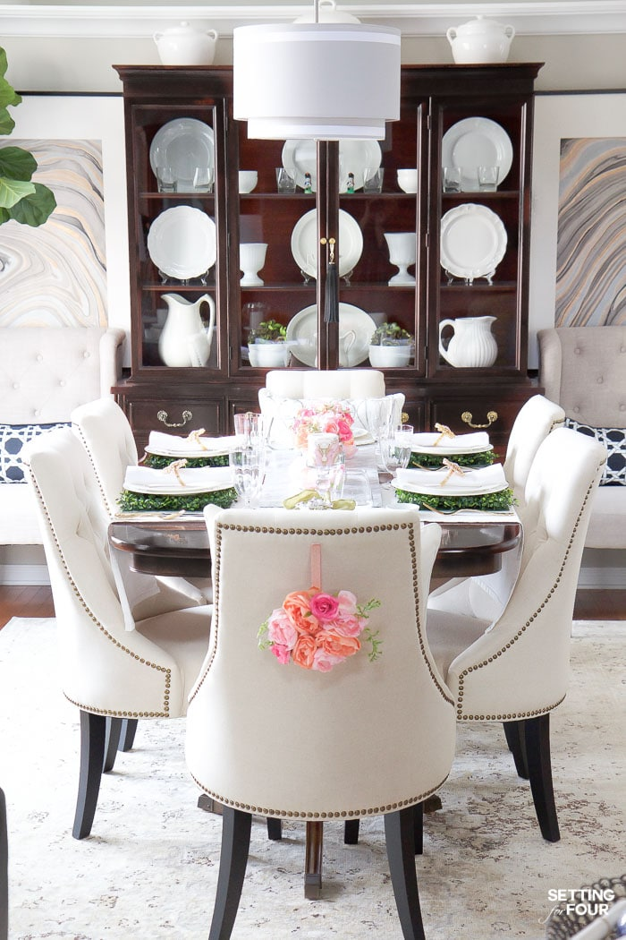 Easter decor ideas for the dining room. DIY floral wreaths for chair backs.