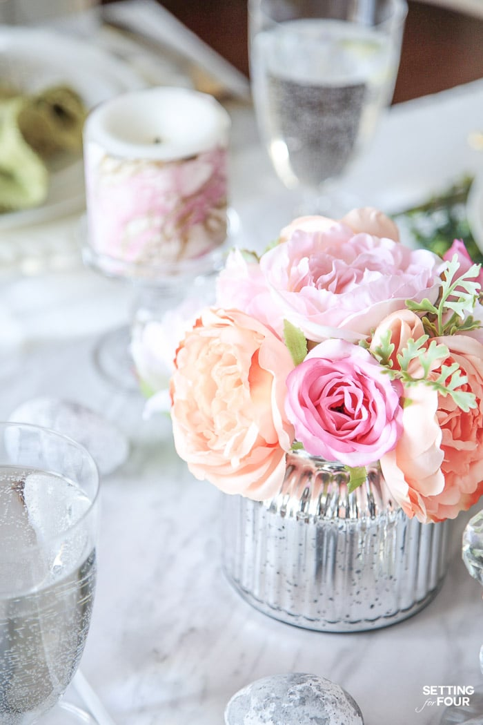 DIY tablescape with faux flower centerpieces and DIY Easter eggs.