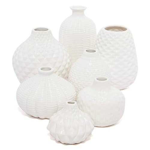 fresh and faux flowers which will both look stunning in this set of 7 artisan bud vases!