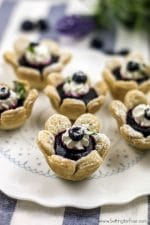 These delicious blueberry flower tarts are fun to make and serve! Satisfy your sweet tooth with this mini fruit filled dessert with a flower shaped crust- perfect for brunch, baby showers, wedding showers and dinner parties!