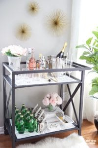 See this quick and easy DIY marble bar cart top and shelf tutorial to give your bar cart the look and elegance of real marble! Marble bar carts are gorgeous but can be so expensive! Get the look of Carrara marble with this easy faux marble hack!