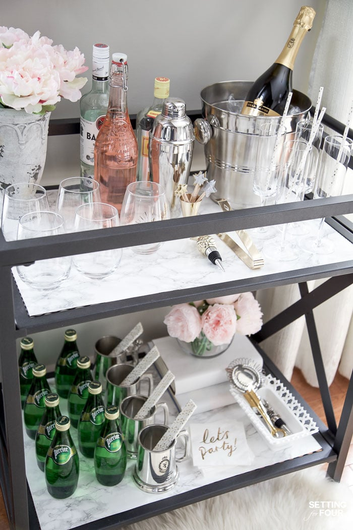 See this quick and easy DIY marble bar cart top and shelf tutorial to give your bar cart the look and elegance of real marble! Marble bar carts are so gorgeous but are SO expensive! Get the look of Carrara marble for less with this easy marble DIY project!