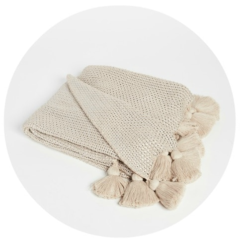 Love tassels and metallics? This stunning throw blanket has both!