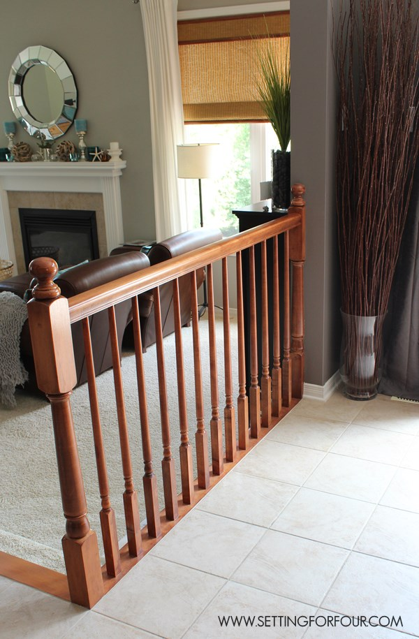 Remove a pony railing from kitchen area.