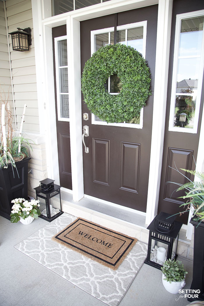 Front Porch Decor Ideas: See the sources to everything here and door paint color! #curbappeal #porch #outdoorrug #planter #wreath #decor #design