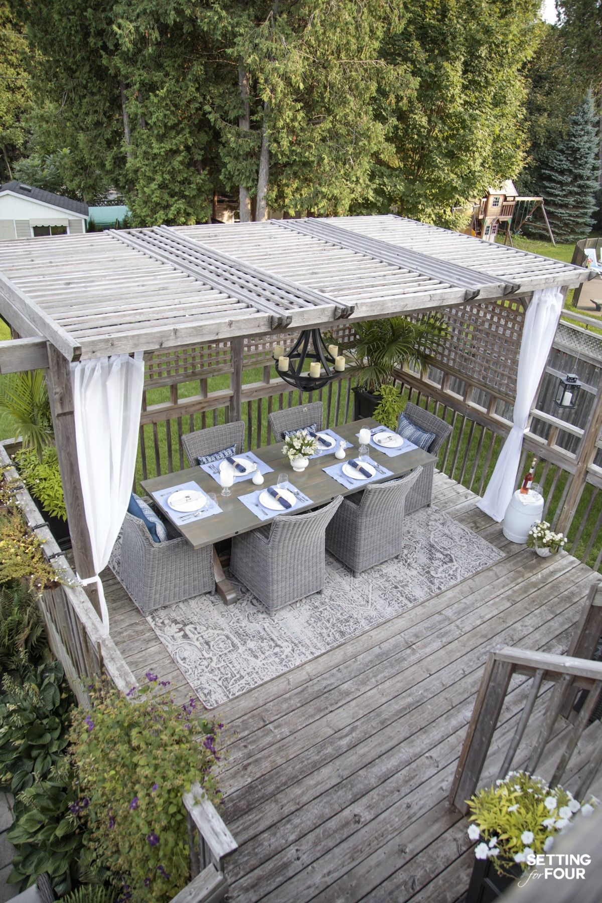 How to Create A Beautiful Pergola Dining Area - Furniture, Rug, Lighting, Table Setting & Decorating Ideas #pergola #outdoor #decor #design #diningroom #arearug #placesetting #landscaping