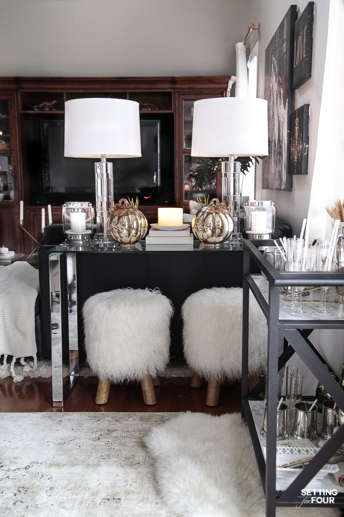 Extra storage and serving space in the dining room with a console table and bar cart. #diningroom #storage #organization #bigger #entertaining #console #barcart