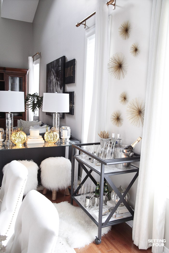 My bar cart in our dining room gives us extra storage and organization! #starburst #walldecor #sunburst #art #barcart #marble #storage #organization