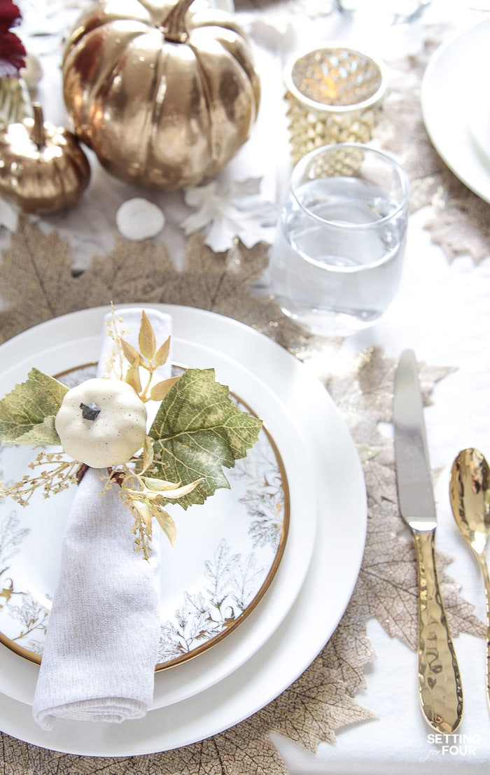 Gold flatware and white dishes decorated for fall. #white #dishes #dinnerware #gold #flatware #leaf #placemats #pumpkins
