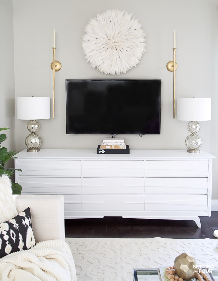 What to Hang Over a TV! #lamps #gray #juju #whitedecor #walldecor #tv #tvwall #gallerywall #diy #repurpose #dresser #gold #whitedecor #arearug