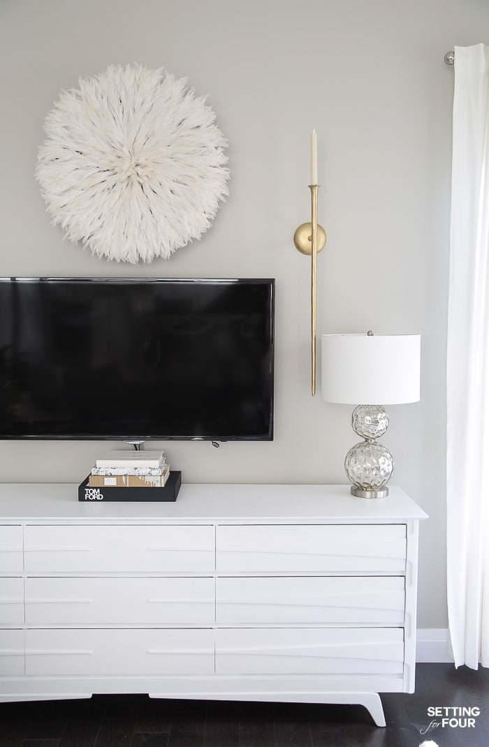 TV Wall Decor Idea - Decorate With A Juju Hat! #lamps #gray #juju #whitedecor #walldecor #tv #tvwall #gallerywall #diy #repurpose #dresser #gold #whitedecor #arearug