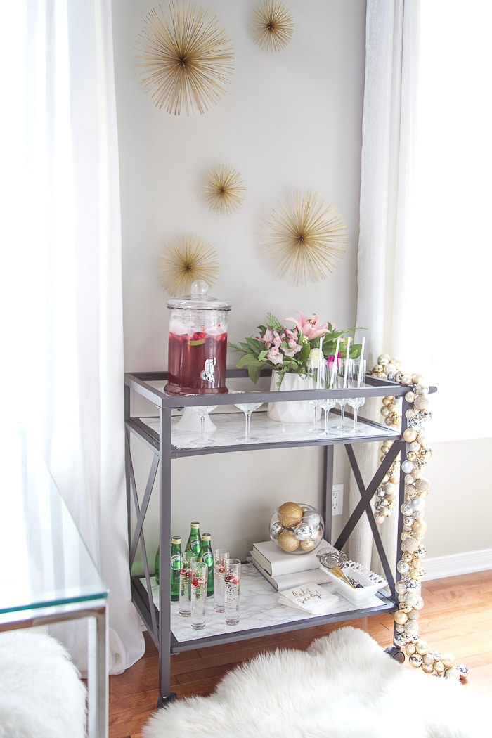 Inexpensive ways to decorate a bar cart for holiday parties. #inexpensive #barcart #holidays #partyplanning #gold #white #graypaint