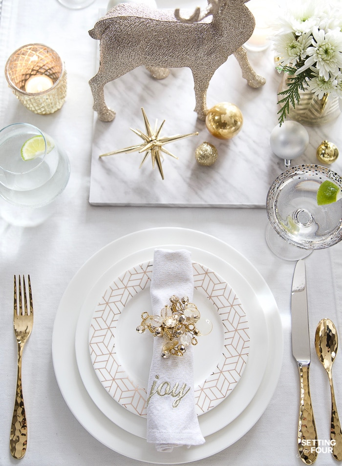 See my Styled and Set Christmas Table Decor Ideas - tips on seating, centerpiece ideas, place setting ideas, festive decor and more! #holidaydinnerware #holidaydecor #placesettingideas #flatware #drinkware #napkins