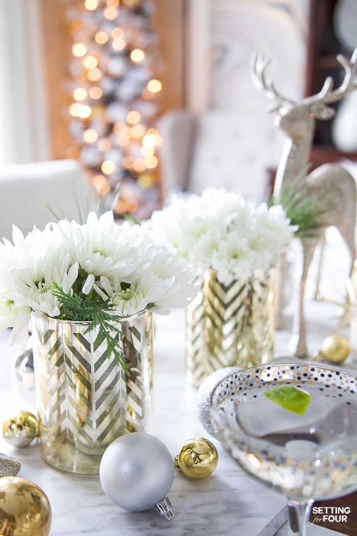 See my Styled and Set Christmas Table Decor Ideas - tips on seating, centerpiece ideas, place setting ideas, festive decor and more! #christmasgreenery #christmasflowers #christmascenterpiece #christmasarrangement #centerpiecedecor #christmasdeer