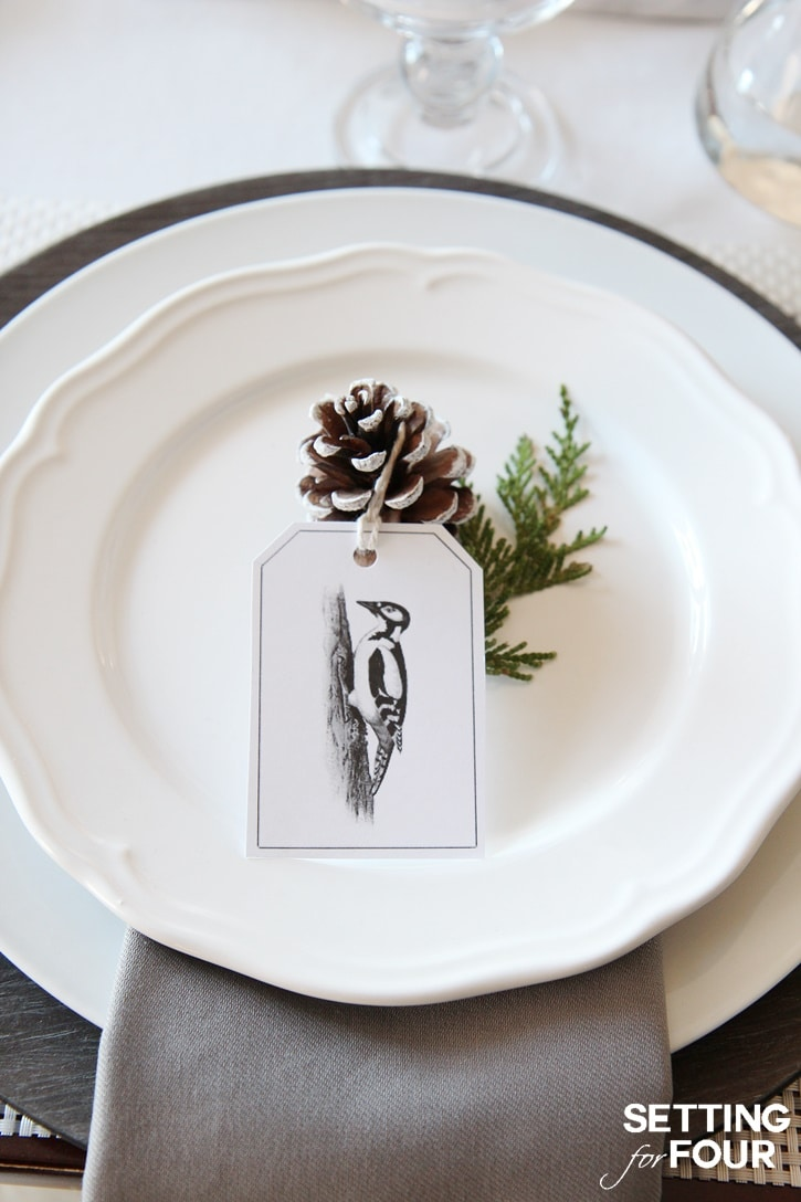 Gorgeous printable woodland tags as place cards on a Christmas table setting.