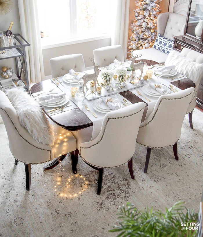 See my Styled and Set Christmas Table Decor Ideas - tips on seating, centerpiece ideas, place setting ideas, festive decor and more! #diningroom #diningchairs #xmasdecorations #holidaydecorations