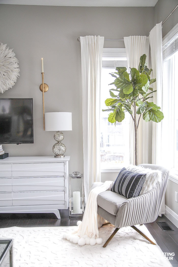 Living Room Makeover and design ideas - New TV Stand, Wall Art, Rug & Pillows! #roomdesign #roomideas #livingroom #swivelchair #furniture #seatingarea #nook #fiddleleaffig #fiddleleaffigtree