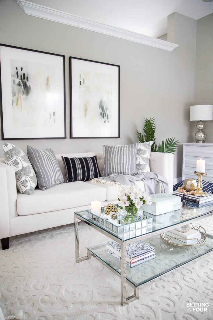 Living Room Makeover and design ideas - New TV Stand, Wall Art, Rug & Pillows! #livingroom #sofa #sofaideas #chesterfield #tuft #paintcolors #gray #grey #tufted #molding #wallmolding