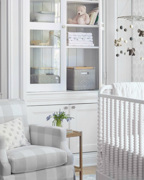 Sophisticated neutral baby room. #baby #room #traditional #crib #decorstyle #storage #mobile