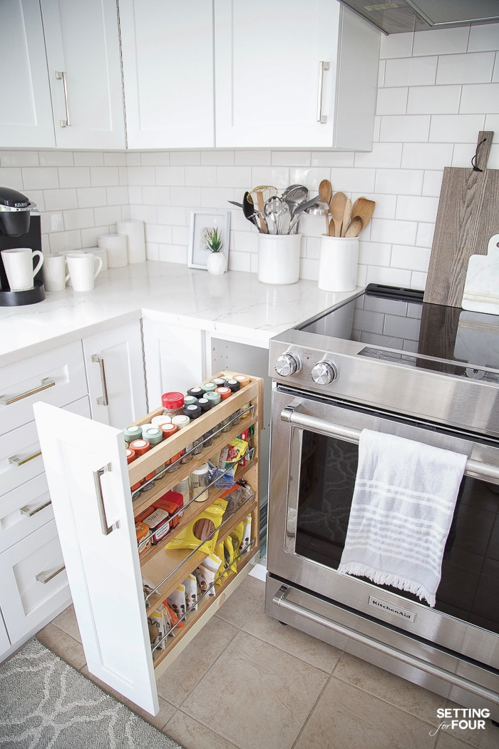 Kitchen cabinet organization ideas. Roll out spice rack in lower cabinet. #kitchen #organization #spicerack #remodel #renovation #homeimprovement