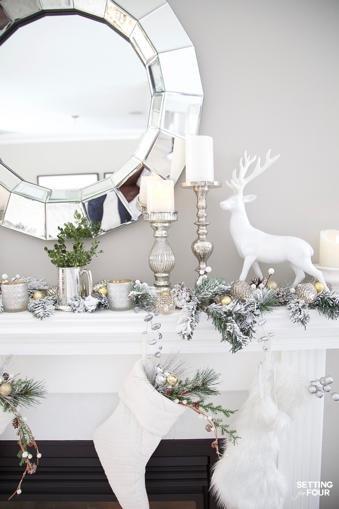 Christmas mantel ideas with garland, deer, candles and stockings. #christmasdecor #xmasdecor #christmasmantel #manteldecor #deer #christmasstockings