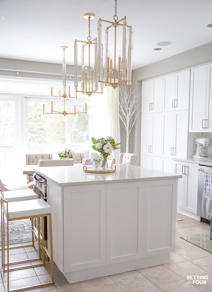 Kitchen remodel ideas. Before and after pictures with details on new white cabinets, lighting