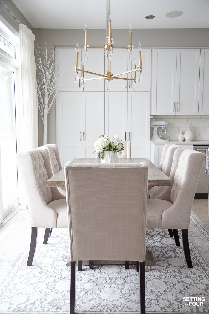 Beautiful beige button tufted dining chairs. Upholstered. Wing back style. Stain resistant and water resistant with scotch guard protector. #upholstery #fabric #dining #chair #tufted