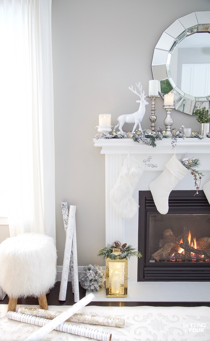 DIY Christmas mantel decor with deer and Pottery Barn stools in living room. #christmasmantel #decoratingideas #livingroom #potterybarn #modern #whimsical