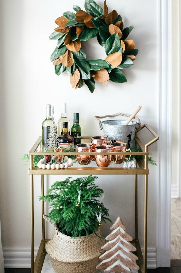 Happy New Year bar cart ideas #barcart #gold #wreath #coppermugs #newyear