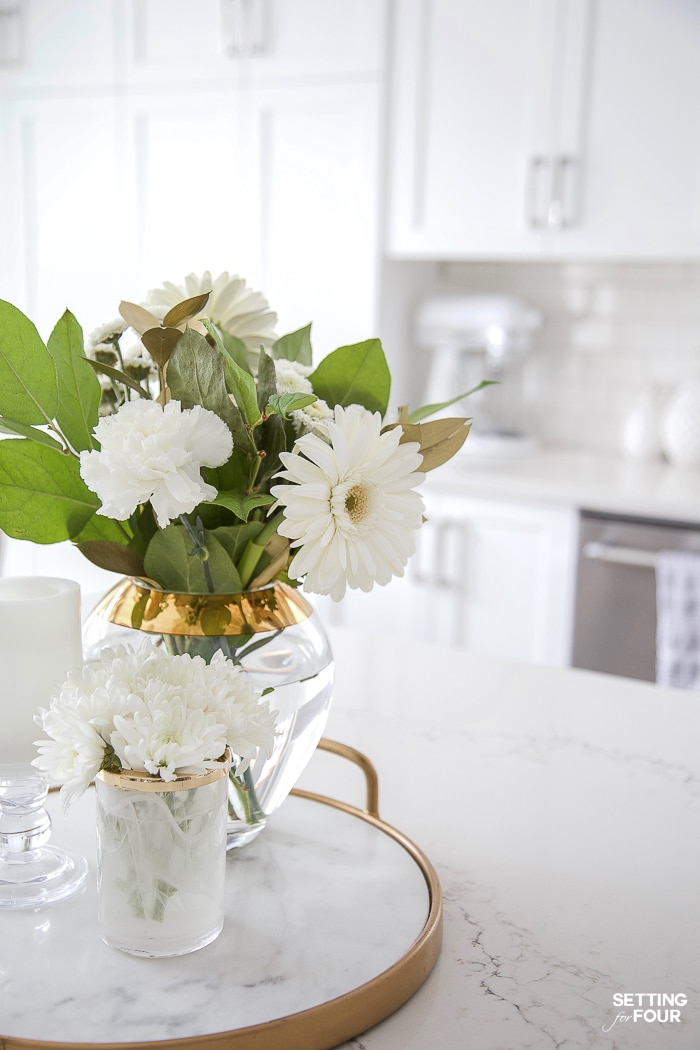 Simple kitchen island decor idea. Centerpiece with gold tray and flowers. #kitchen #island #decor #decorideas #glam #modern
