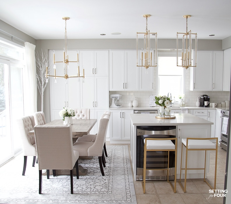 Gray and white kitchen layout after remodeling. Eat in kitchen with dining table, kitchen lighting over the table, pendants over the island. Modern mixed with traditional style. #kitchen #white #simple #transitional #traditional #glam #bulkheads