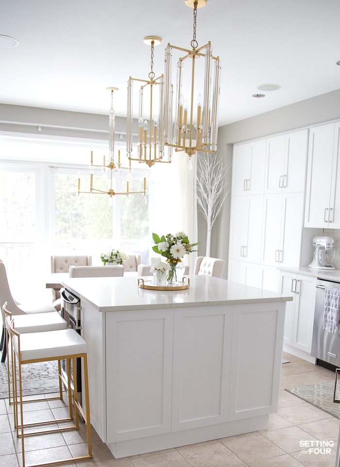 Dream kitchen ideas: Caesarstone quartz countertop with white cabinets, gold and crystal pendant lights and neutral white subway tile. #kitchen #decor #design #interiordesign #designer