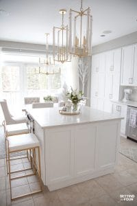 Kitchen remodel ideas. Before and after pictures with details on new white cabinets, lighting and Caesarstone quartz countertops. #kitchen #renovation #white #cabinets #caesarstone #quartz #countertop #subway #tile #backsplash