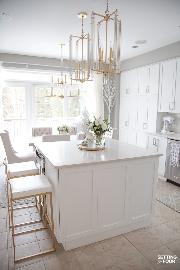 5 Interior Design Tricks To Brighten a Dark Room! These designer tricks will make your room feel bigger too! #whitekitchen #kitchendesign #kitchenremodel #remodel #kitchen #lighting #gold #pendants