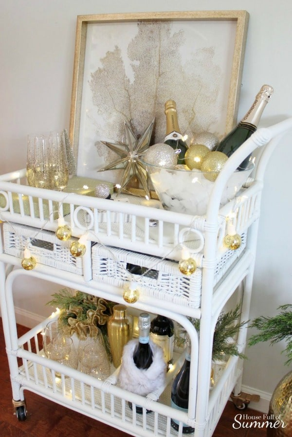 Vintage wicker bar cart for New Year's Eve party #stringlights #barcart #newyearseve #decor