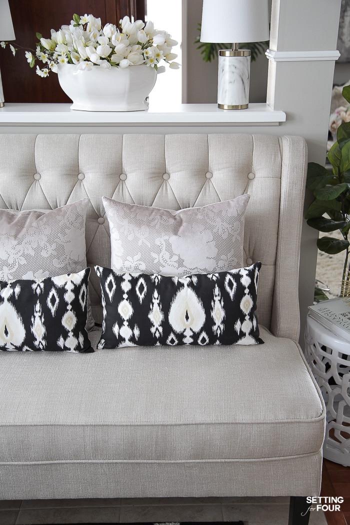Foyer decor idea with settee for seating. #settee #bench #foyer #decor #interiors #decorideas #pillows
